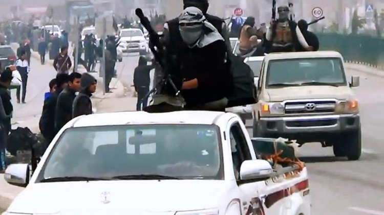 An image grab taken from a propaganda video released on March 17, 2014 by al-Furqan Media allegedly shows Islamic State fighters driving on a street in Iraqi city of Ramadi
