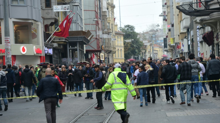 Turkish police push people away after an explosion on the pedestrian Istiklal avenue in Istanbul on March 19, 2016