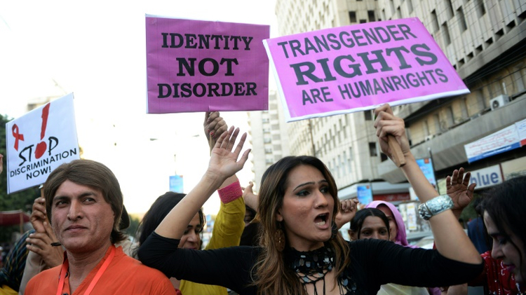 Pakistani transgenders carry signs at a rally in Karachi on November 30, 2013
