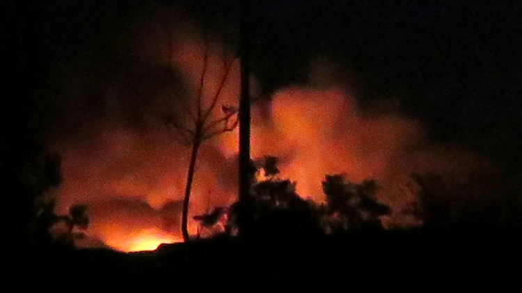 Flames and smoke rise from the Mazzeh airbase on the outskirts of Damascus following what the Syrian army said were Israeli missile strikes