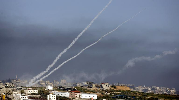 Smoke trails rise up into the sky after rockets were launched toward southern Israel from the town of Beit Hanun in the northern Gaza Strip, on January 4, 2009