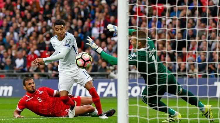 Malta's goalkeeper Andrew Hogg (right) saved many England shots