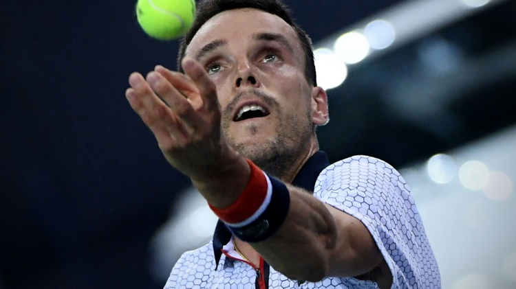 Spain's Roberto Bautista Agut broke France's Jo-Wilfried Tsonga three times in the first set and once in the second as he raced through in 1hr 12min