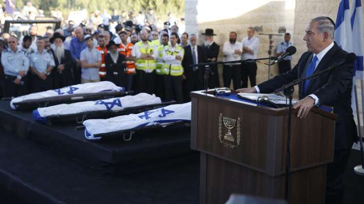 Israeli Prime Minister Benjamin Netanyahu delivers a speech on July 1, 2014 in the cemetery of Modiin during the funeral of Gilad Shaer and Naftali Frenkel, both 16, and 19-year-old Eyal Ifrach