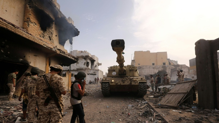 Forces loyal to Libya's UN-backed Government of National Accord gather in the coastal city of Sirte, east of the capital Tripoli, during an operation to clear the Islamic State group jihadists from the city, on October 14, 2016