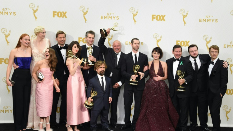 "The cast, writers, and directors of hit HBO TV show ""Game of Thrones,"" pictured on September 20, 2015 at the Emmy Awards, have more to celebrate as the show pulls in nearly nine million viewers for the finale"