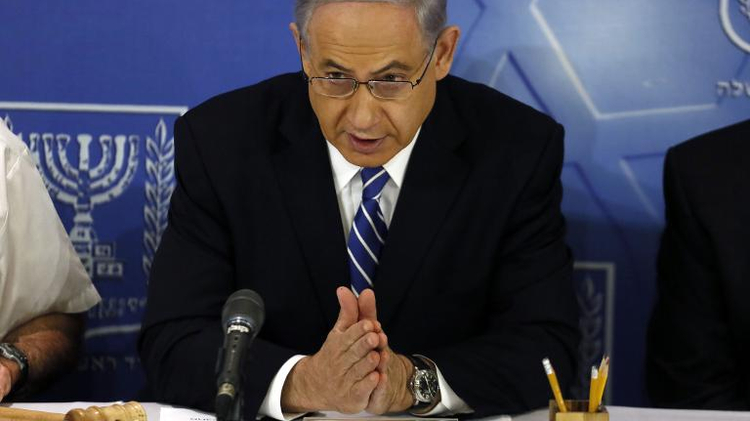 Israeli Prime Minister Benjamin Netanyahu speaks as he opens the weekly cabinet meeting at the Defense Ministry in the costal city of Tel Aviv on August 24, 2014