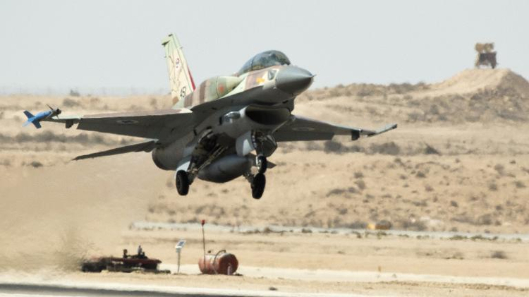 An F-16 warplane takes off from the Ramon Air Force base in the Negev Desert, southern Israel, on October 21, 2013