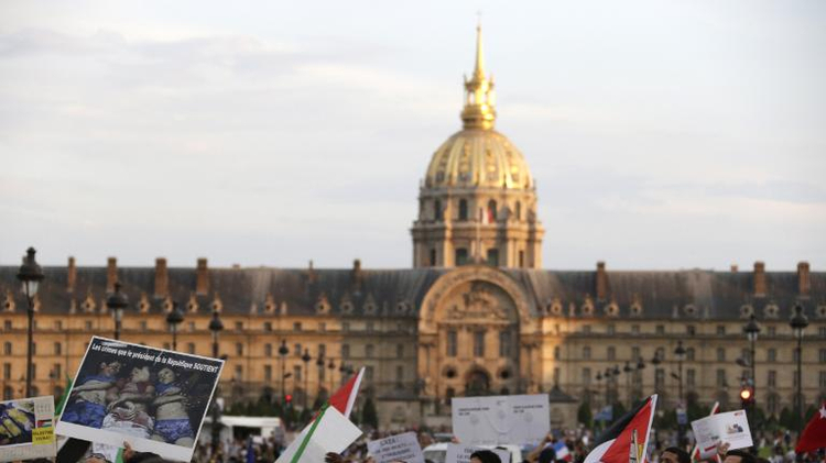 People gather in front of the Invalides during a demonstration to denounce Israel's military campaign in Gaza on July 23, 2014 in Paris