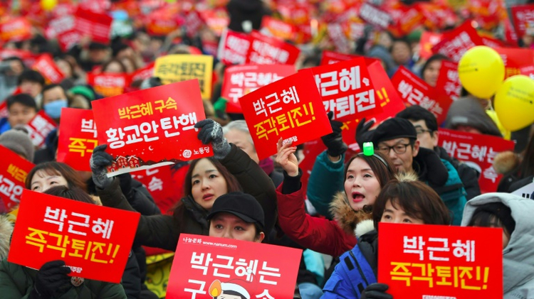 Protesters in Seoul pictured on December 24, 2016, attending a rally calling for the immediate removal of South Korea's impeached President Park Geun-Hye