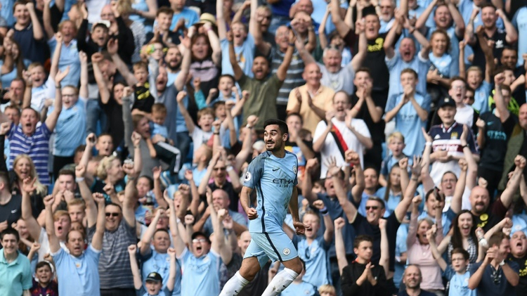 Manchester City's German midfielder Ilkay Gundogan celebrates scoring their fourth goal during the English Premier League football match between Manchester City and Bournemouth