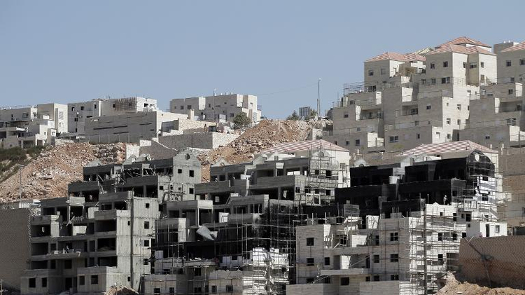 Buildings under construction are seen in the Israeli settlement of Beitar Illit near the Palestinian West Bank village of Wadi Fukin, on September 4, 2014