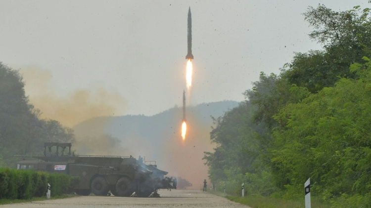 Ballistic rockets are test fired by North Korean artillery units at an undisclosed location in the country on September 6, 2016