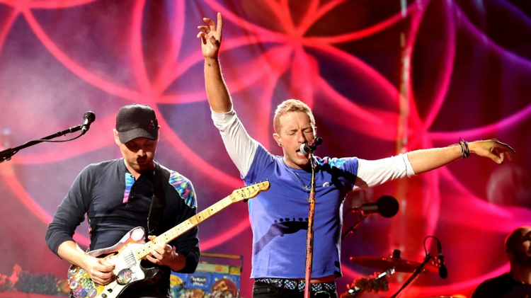 Jonny Buckland (L) and Chris Martin of Coldplay perform at the Rose Bowl in Pasadena, California, on August 20, 2016