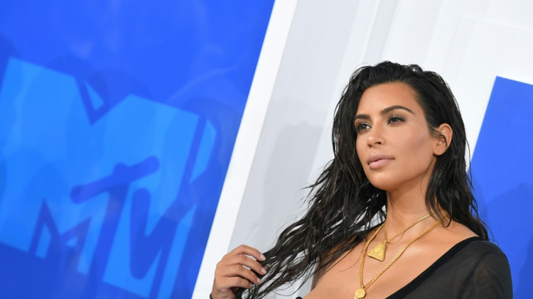 Kim Kardashian, the world's highest paid reality television star, was held at gunpoint in a luxury Paris apartment by robbers who made off with $10 million in valuables