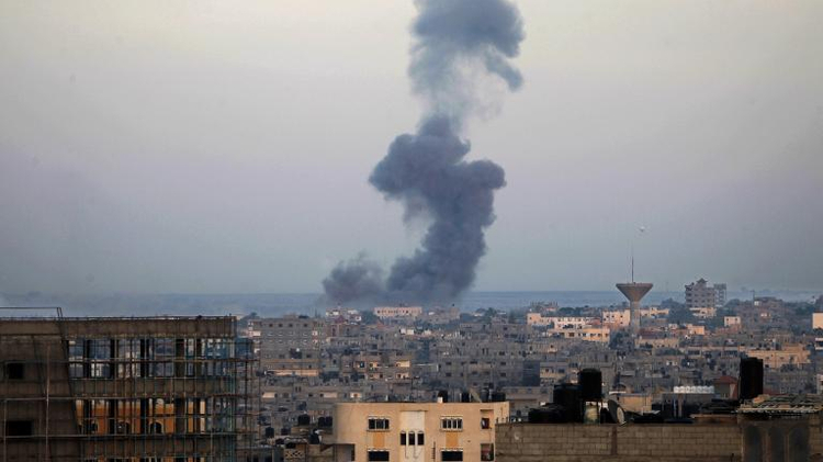 Smoke billows from buildings following an Israeli air strike in Rafah, in the southern Gaza Strip, on July 31, 2014