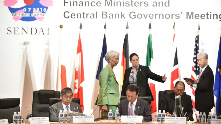 IMF Managing Director Christine Lagarde (top, C) walks behind Governor of the Bank of Japan Haruhiko Kuroda (L) and Japanese Finance Minister Taro Aso (C) prior to the start of the G7 meeting in Sendai on May 20, 2016