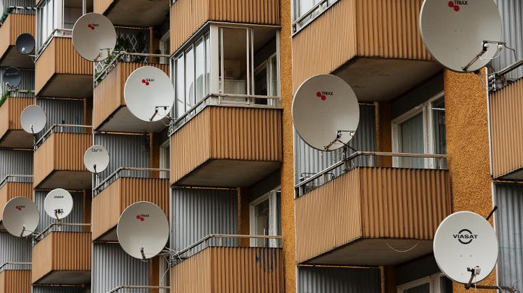 File photo: Satellite dishes are seen on balconies at the Hovsjoe district in south-western Soedertaelje, on November 20, 2013