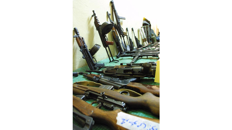 "Weapons and ammunition seized by the Jordanian security forces during a hunt for wanted ""outlaws"" are collected at the central police station in Amman on November 15, 2002"