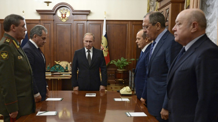 President Vladimir Putin (C), Defence Minister Sergei Shoigu (2ndL), Army chief of staff Valery Gerasimov (L), head of the FSB Alexander Bortnikov (3rdR), Foreign Minister Sergei Lavrov (2ndR) and Foreign Intelligence Chief Mikhail Fradkov (R)