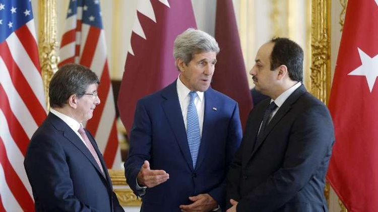(From L) Turkish Foreign Minister Ahmet Davutoglu, US Secretary of State John Kerry and Qatari Foreign Minister Khaled al-Attiyah speak after their meeting, on July 26, 2014, at the foreign ministry in Paris