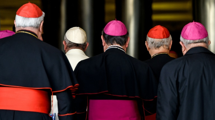 Pope Francis (2-L) arrives with bishops and cardinals for the morning session on the last day of the Synod on the Family at the Vatican on October 24, 2015