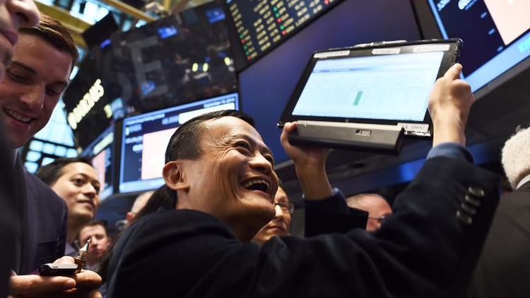 Chinese online retail giant Alibaba founder Jack Ma (C) on the floor at the New York Stock Exchange on September 19, 2014