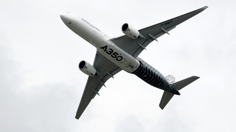The Airbus A350 jet airliner takes part in a flying display at the Farnborough Airshow, south west of London, on July 12, 2016