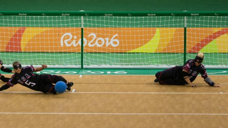 In goalball, blind or partially blind players wear eye shades to make conditions equal,then try to score goals with a ball containing bells to help the players orientate themselves