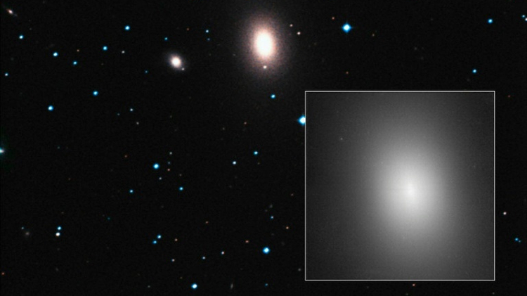 A photo released by the European Space Agency/Hubble shows the elliptical galaxy NGC 1600, 200 million light-years away — at the centre of the image and highlighted in the box