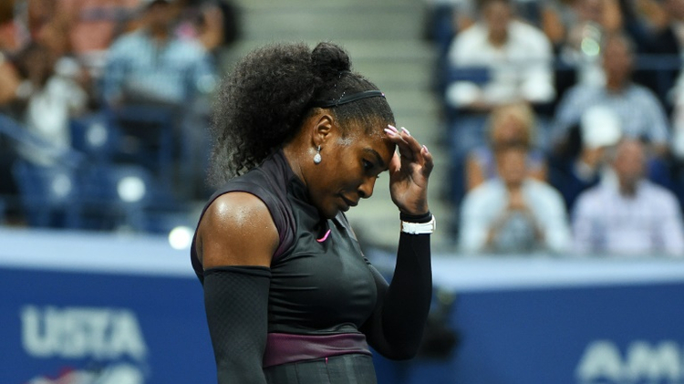 Serena Williams of the US reacts after losing a point against Karolina Pliskova of Czech Republic during their 2016 US Open semi-final match, at the USTA Billie Jean King National Tennis Center in New York, on September 8