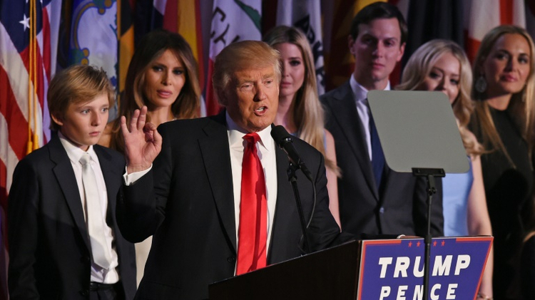 Republican presidential nominee Donald Trump arrives on stage with his family to sppeak to supporters during election night at the New York Hilton Midtown in New York on November 9, 2016