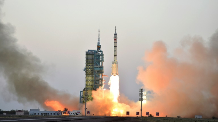 China's Long March-2F carrier rocket transporting the manned spacecraft Shenzhou-11 blasts off from the launch pad at the Jiuquan Satellite Launch Center in north-western Gansu Province, on October 17, 2016