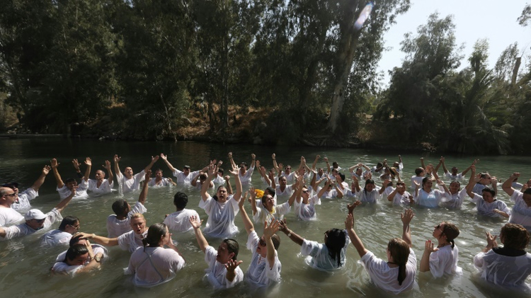 Christians believe Jesus was baptized in the Jordan River by John the Baptist, and many visit the site to take part in mass baptism ceremonies, such as these Brazilian pilgrims in 2016