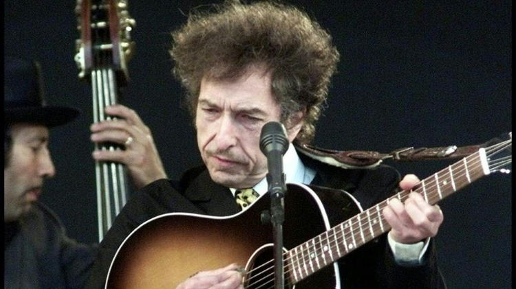 Bob Dylan performs at the Roskilde Festival in Denmark in 2001