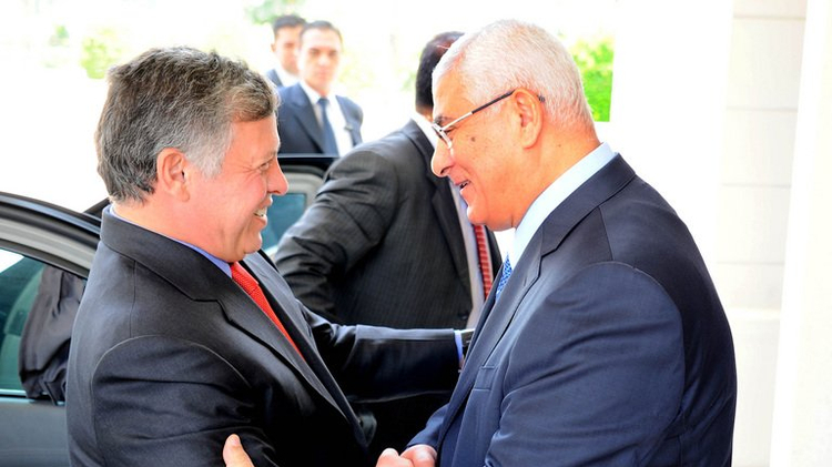 Egypt's Interim President Adly Mansour welcomes Jordan's King Abdullah II in Cairo, on July 21, 2013