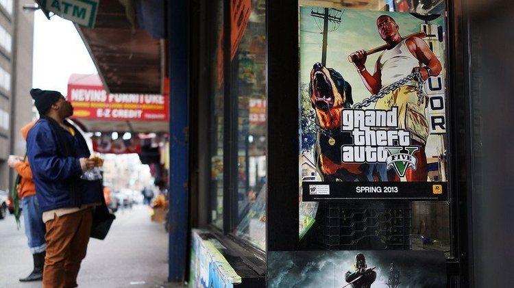 An advertisement for the new Grand Theft Auto displayed outside of a gaming store on January 11, 2013 in New York City