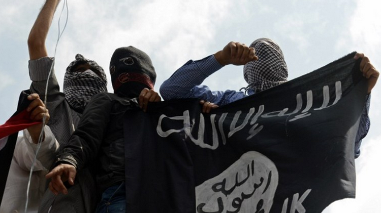 Illustrative photo of men holding up an Islamic State flag.