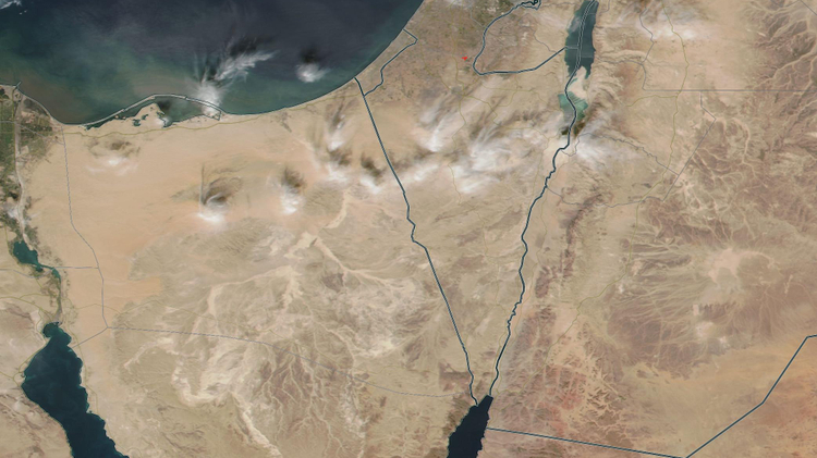 NASA satellite images shows smoke from numerous fires burning around Israel.  Red dots indicate locations of fires.