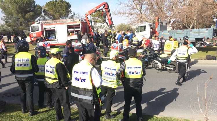 Emergency responders on the scene of a suspected truck ramming attack on January 8, 2016 in Jerusalem