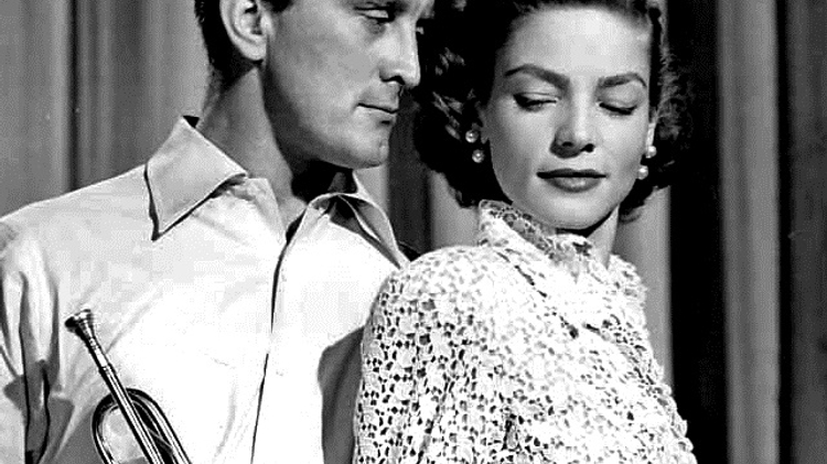 Promotional photo of Kirk Douglas and Lauren Bacall in 'Young Man with a Horn', 1950.