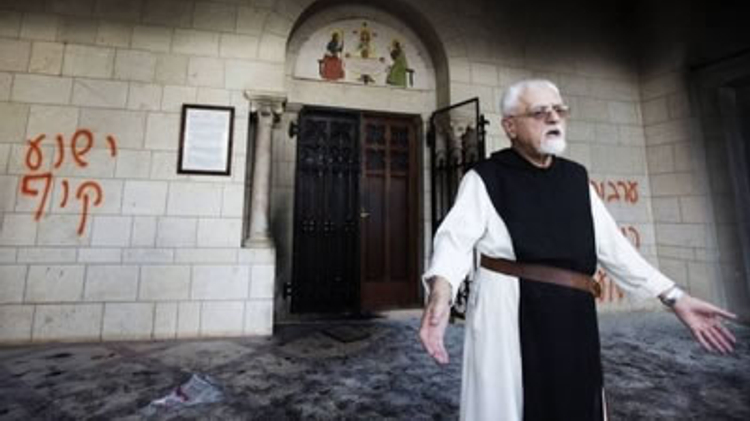 Monk at Latrun monastery in Israel after hate graffiti was painted on the walls (April 2014)