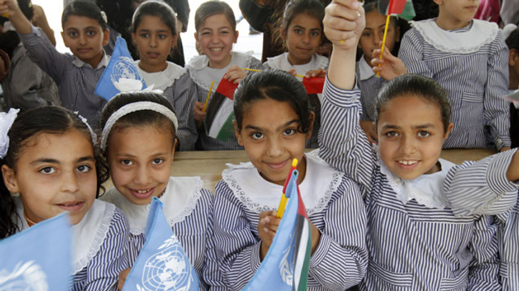 Palestinian school children attend the opening of a UN Relief and Works Agency (UNRWA) school in northern Gaza Strip