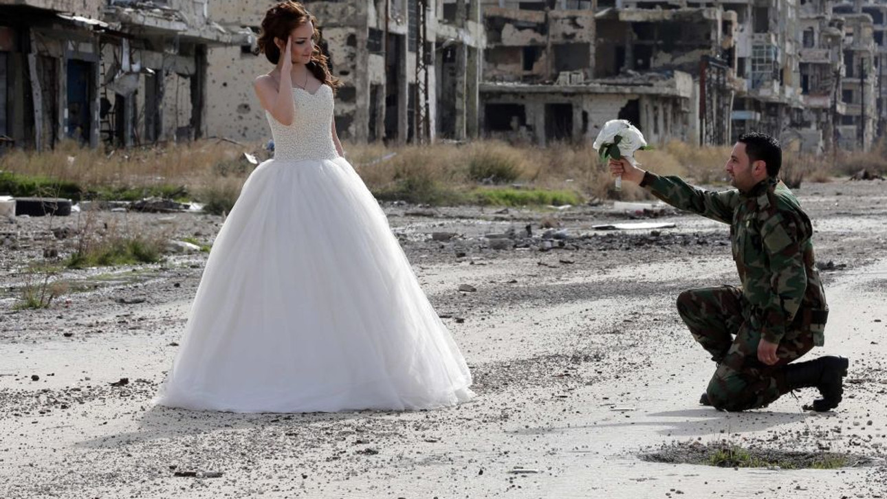 Syrian couple's wedding photos prove love triumphs over war