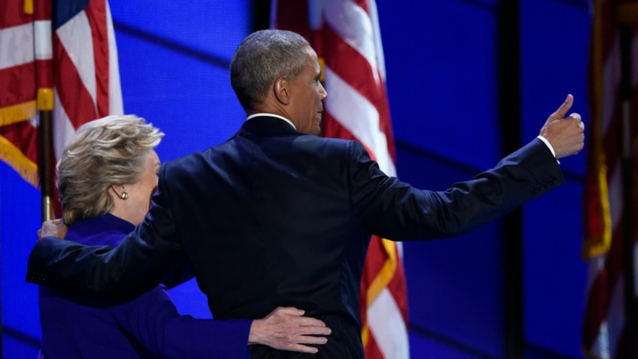Obama passes the baton to Clinton as Democrats strive for unity