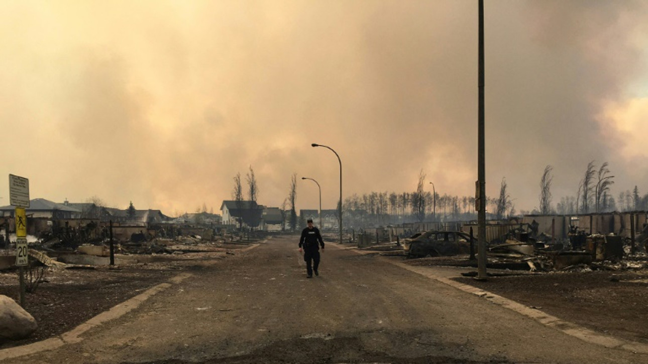 Tens of thousands flee western Canada's raging wildfires