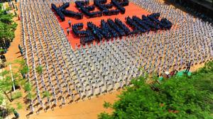 Millions stretch and bend for International Yoga Day