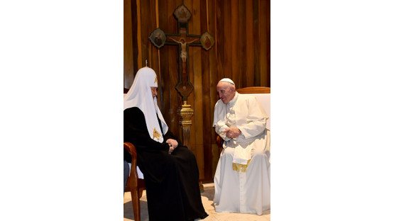 Pope, Russian patriarch kiss at start of historic meet