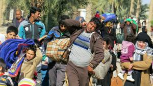 Starving Iraqis risk all to flee IS's crumbling rule