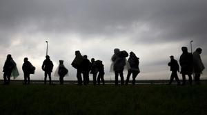 Turkey's Erdogan threatens to open borders to migrants after EU Parliament vote
